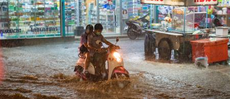 Motorbike navigates flash flood in Thailand